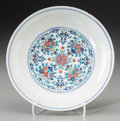 Asian:Chinese, A Chinese Doucai Enameled Porcelain Floral Dish, Qing Dynasty, 19thcentury. Marks: Six-character Yongzheng mark in blue und...