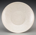 Asian:Chinese, A Chinese Molded Dingyao Porcelain Saucer, Southern Song Dynasty.6-1/2 inches diameter (16.5 cm). PROVENANCE:. Christie's...