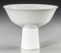Asian:Chinese, A Chinese Incised White Glazed Porcelain Stem Bowl, late QingDynasty. Marks: Incised six-character Yongzheng mark and of a ...