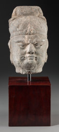 Asian:Chinese, A Chinese Carved Stone Head of an Official with Stand, Tang Dynasty, circa 618-907. 12-1/2 inches high (31.8 cm). PROVENAN...