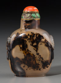 A Large Chinese Agate Snuff Bottle with Carved Mask Handles, Qing dynasty, 19th century 3-1/2 inches high (8.9 cm