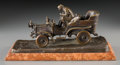 Bronze:European, A Patinated Bronze Group of a Man Driving an Early Open Automobile,circa 1915. 5-5/8 h x 12 w x 5-3/4 d inches (14.3 x 30.5...