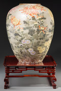Asian:Japanese, A Japanese Enameled Porcelain Vase with Peony and Floral Motifs onCarved Stand. 17-1/2 inches high (44.5 cm) (vase). ... (Total: 2Items)