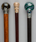 Decorative Arts, British:Other , Three Various Canes with Glass, Sterling Silver, Tiger's Eye, andGold-Filled Mounts, early 20th century. Marks: (various). ...(Total: 3 Items)