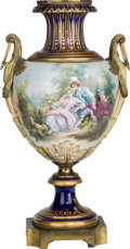 Ceramics & Porcelain, A French Sevres-Style Porcelain and Gilt Bronze Urn, late 19th century. Marks: J. PASCAULT, (Sevres). 30-1/4 inches high...