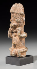 Decorative Arts, Continental, An African Stone Carving. 5 inches high...