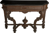 A Renaissance Revival Carved Oak Console with Black Slate Top, late 19th century 38 h x 54-3/4 w x 21-5/8 d inches