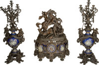 A Three-Piece Renaissance Revival Patinated and Enameled Metal Clock Garniture, late 19th century 43-1/2 inches hi