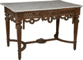 Furniture : French, A Louis XVI-Style Carved Walnut Salon Table with Carrara MarbleTop. 30-1/2 h x 45-1/2 w x 29 d inches (77.5 x 115.6 x 73.7 ...