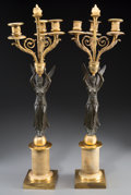 Decorative Arts, French:Other , A Pair of Empire Patinated and Gilt Bronze Three-Light FiguralCandelabra, 19th century. 24-1/2 inches high (62.2 cm). ... (Total:2 Items)
