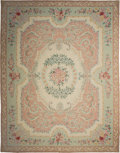 Textiles, A Large Needlepoint Carpet in the Victorian Taste. 180-1/2 x 135-1/2 inches (458.5 x 344.2 cm). ...