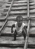Photographs, W. Eugene Smith (American, 1918-1978). Baby boy on railroad track from A Man of Mercy, 1954. Gelatin silver. 13-5/8 ...