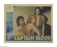 "Captain Blood (Warner Brothers, 1935). Lobby Card (11"" X 14""). Errol Flynn plays Peter Blood, a physician who..."