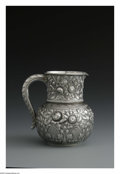 Silver Holloware, American:Water Pitchers, An American Silver Water Pitcher. Mark of Gorham, Providence, RI,1887. The repousse pitcher decorated with a heavy floral...
