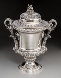 Silver & Vertu:Hollowware, A Rebecca Eames and Edward Barnard I Silver Lidded Wine Cooler with Bacchanal Motif, London, 1826. Marks: (lion passant), (l...