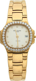 Timepieces:Wristwatch, Patek Philippe Ref. 4700/530 Lady's Gold Nautilus With Diamonds. ...