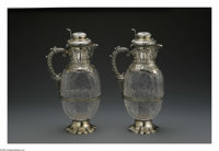 Two English Silver and Crystal Clarets Mark of W & G Sissons, Sheffield, England, 1908  The cut crystal clarets with...