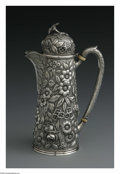 Silver Holloware, American:Chocolate Pots, An American Silver Chocolate Pot. Mark of James R. Armiger,Baltimore, MD, Late Nineteenth Century. The floral repousse ch...