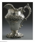 Silver Holloware, American:Water Pitchers, An American Silver Water Pitcher. Mark of Redlich & Co., NewYork, NY, Late Nineteenth Century. The Art Nouveau floral rep...