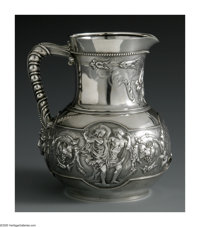 An American Silver Water Pitcher Mark of Tiffany & Co., New York, NY, 1853  The bulbous pitcher decorated with a rep...