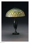 Art Glass:Tiffany , An American Glass and Bronze Lamp. Tiffany Studios, Early TwentiethCentury. The Favrile glass 'Acorn' shade raised on a b... (Total: 2Items)