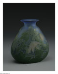 Glass, A French Glass Vase. Emile Galle, 1890. The blue ground vase overlaid with green and white and etched to depict flowers an...