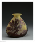 Glass, A French Glass Vase. Emile Galle, c.1890. The yellow ground vase overlaid in red and etched to depict fushia flowers, irid...