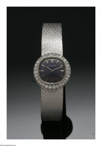 A Ladies 18K White Gold And Diamond Patek Philippe Wrist Watch  The 20 jewel movement, model number 4113 1, the case set...