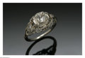 Jewelry, A Gold And Diamond Ring. The 18K white gold ring with a filigree mount set with three diamonds, two small diamonds on each... (Total: 1 Item Item)