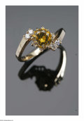 Estate Jewelry:Rings, A Ladies 14K Yellow Gold Ring Centered With A Round Full Cut FancyYellow Diamond. The 14K gold band weighing 3.9 gms moun...