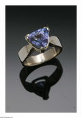 Estate Jewelry:Rings, A Ladies 14K White Gold Solitaire Fashion Ring With Triangular CutTanzanite. The band weighing 6.2 gms mounted with a tri...
