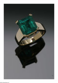 Estate Jewelry:Rings, A Ladies 18K Yellow Gold Solitaire With Square Step Cut Emerald. The 18K Yellow gold band weighing 7.5 gms mounted with a ...