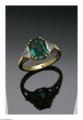 Estate Jewelry:Rings, A Ladies 18K Yellow Gold Ring Centered With An Emerald Cut Emerald And Two Trillion Cut Diamonds. The band weighing 4.8 gm...