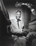 Photographs:Gelatin Silver, Herman Leonard (American, 1923-2010). Nat King Cole, NYC,1949. Gelatin silver, printed later. 12 x 9-3/8 inches (30.5 x...