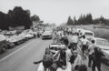 Photographs:Gelatin Silver, Burk Uzzle (American, b. 1938). Cars at Woodstock, 1969.Gelatin silver. 6-1/2 x 10 inches (16.5 x 25.4 cm). Signed and ...