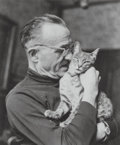 Photographs, Pierre Molinier (French, 1900-1976). Portrait with a cat. Gelatin silver. 5 x 4-1/8 inches (12.7 x 10.5 cm). Stamped by ...