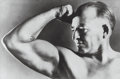 Photographs:Gelatin Silver, Unknown Artist (20th Century). Strong man, 1946. Gelatin silver. 7-1/2 x 11-3/8 inches (19.1 x 28.9 cm). Annotated in in...