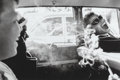 Photographs, Charles Harbutt (American, 1935-2015). Boys Smoking in Car, 1963. Gelatin silver, printed later. 8 x 12 inches (20.3 x 3...