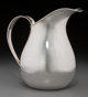 An Allan Adler Silver Pitcher, Los Angeles, California, circa 1950-1960 Marks: ALLAN ADLER, STERLING 8-1/4 inches high...