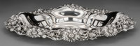 An American Silver Dish with Daisy Motif, early 20th century Marks: STERLING 2-1/2 h x 16-1/4 w x 1
