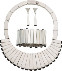 A Four-Piece Antonio Pineda Mexican Silver and Obsidian Matchstick Jewelry Suite, Taxco, circa 1960 Marks: ANTO