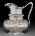Silver & Vertu:Hollowware, A Reed & Barton Silver Repoussé Water Pitcher with Poppy and Rose Motif, Providence, Rhode Island, circa 1900. Marks: (eagle...