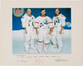 Explorers:Space Exploration, Apollo 16 Large White Spacesuit Color Photo, Crew-Signed on thePresentation Mat to Houston Oilers Owner Bud Adams. ... (Total: 2Items)