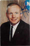 Autographs:Celebrities, Neil Armstrong Signed Business Suit Pose Color Postcard Photo....
