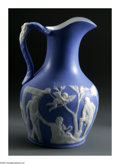 Art Glass:Other , AN ART GLASS PITCHER. The mold-blown pitcher in the style ofJasperware with Grecian figures to body. 7.25in. tall. ...
