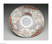A JAPANESE MEIJI IMARI CHARGER Maker unknown, Late 18th Century  The shallow-footed circular form with triplicate brocad...