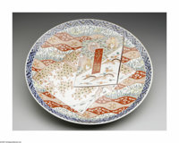 A JAPANESE MEIJI IMARI CHARGER Maker unknown, 1910  The footed circular form with non-repeating brocade pattern in overg...