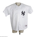 Autographs:Others, Yogi Berra Signed Jersey. Replica New York Yankees pinstripedjersey makes a fine home for this stocky Hall of Fame catcher...