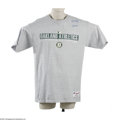 Baseball Collectibles:Uniforms, Circa 2003 Miguel Tejada Game Worn T-Shirt. Oakland Athletics grey t-shirt shows light wear from time spent on the field wi...