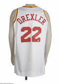 Basketball Collectibles:Others, Clyde Drexler Signed Jersey. Perfect replica of the Glide's home white mesh Rockets gamer is signed on verso in flawless s...